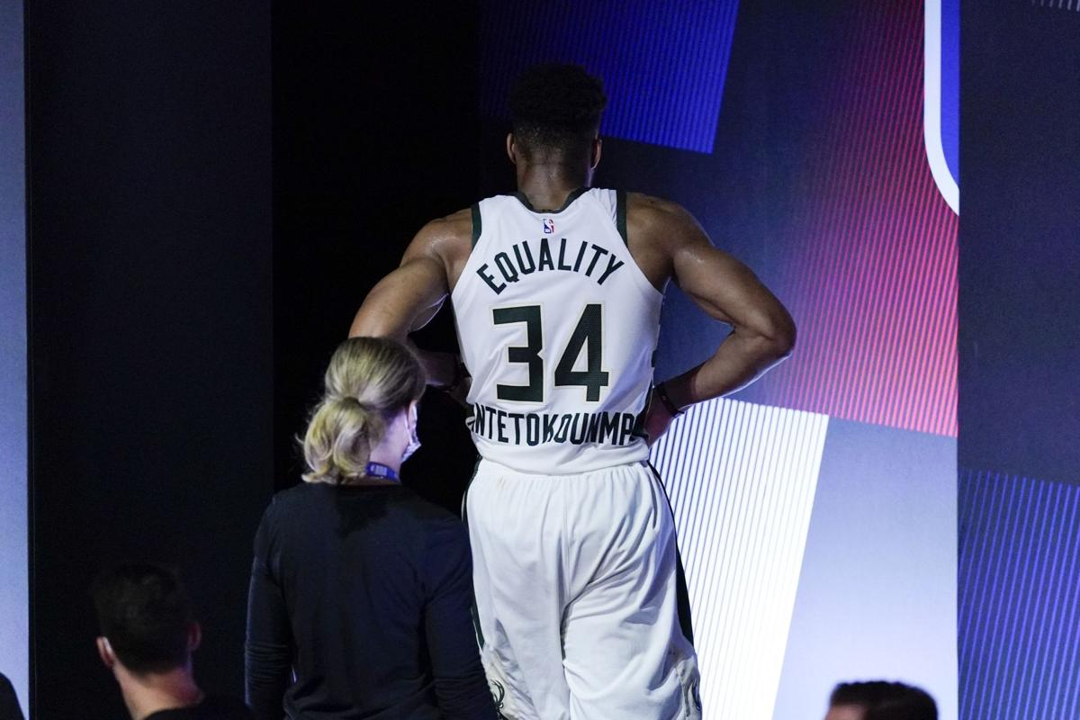 Giannis Antetokounmpo leaves court, AP photo