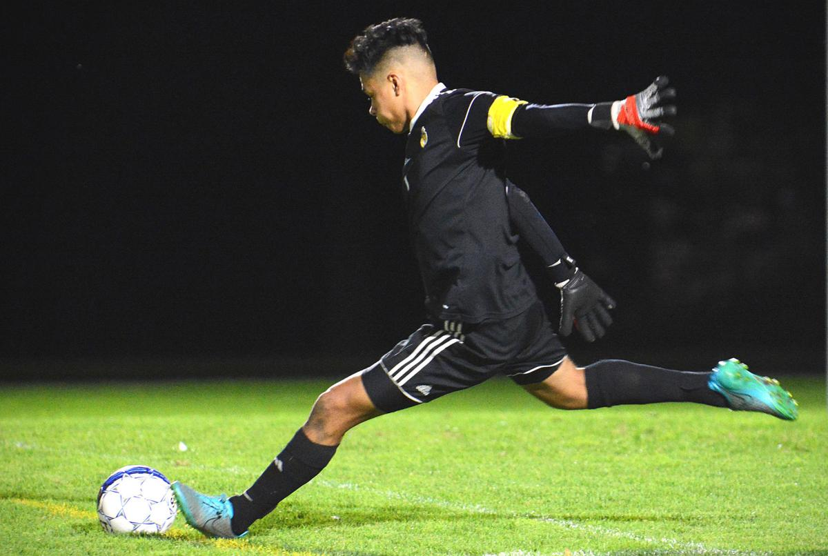 Prep boys soccer photo: Madison West goalkeeper Oscar Herrera