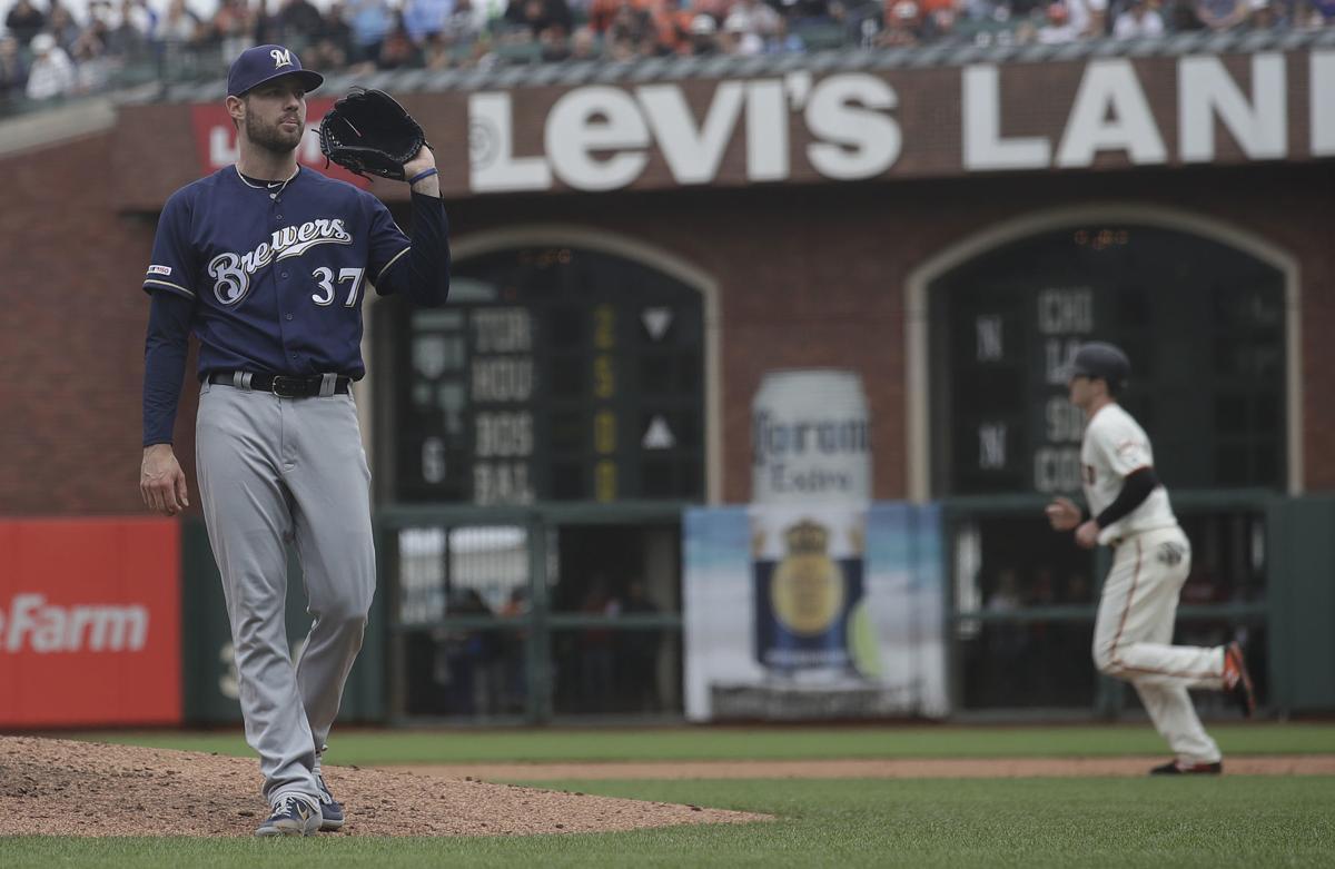Adrian Houser, AP photo
