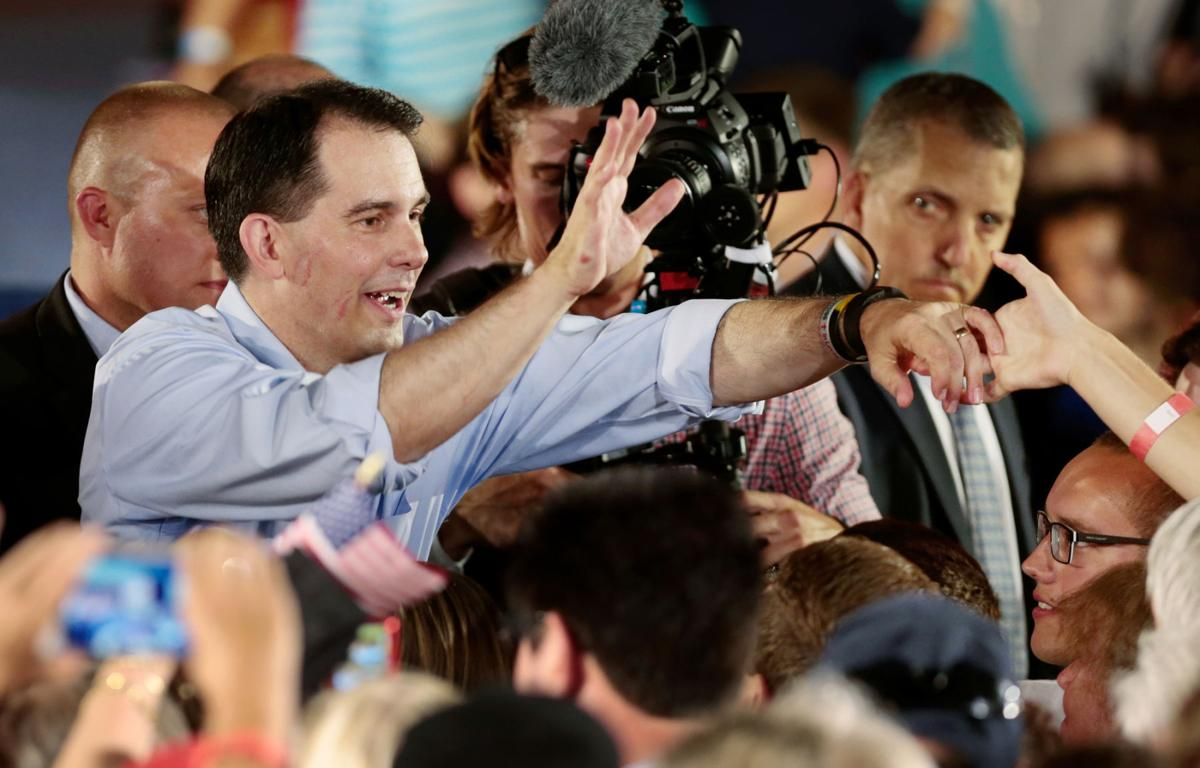 Scott Walker greets crowd Monday