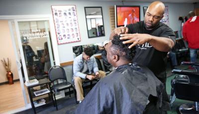 Spencer cutting Jeremiah's hair