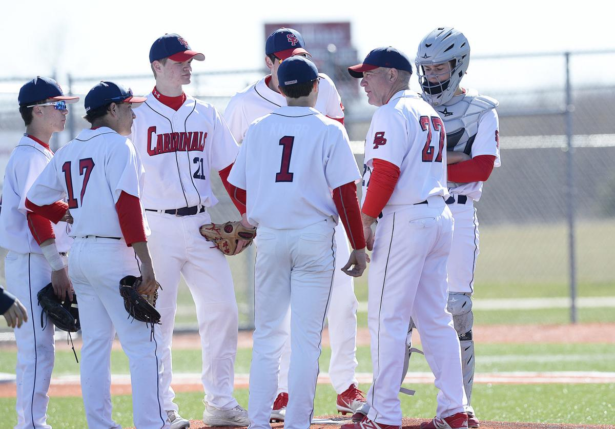 WIAA state baseball photo: Sun Prairie holds a conference at the mound