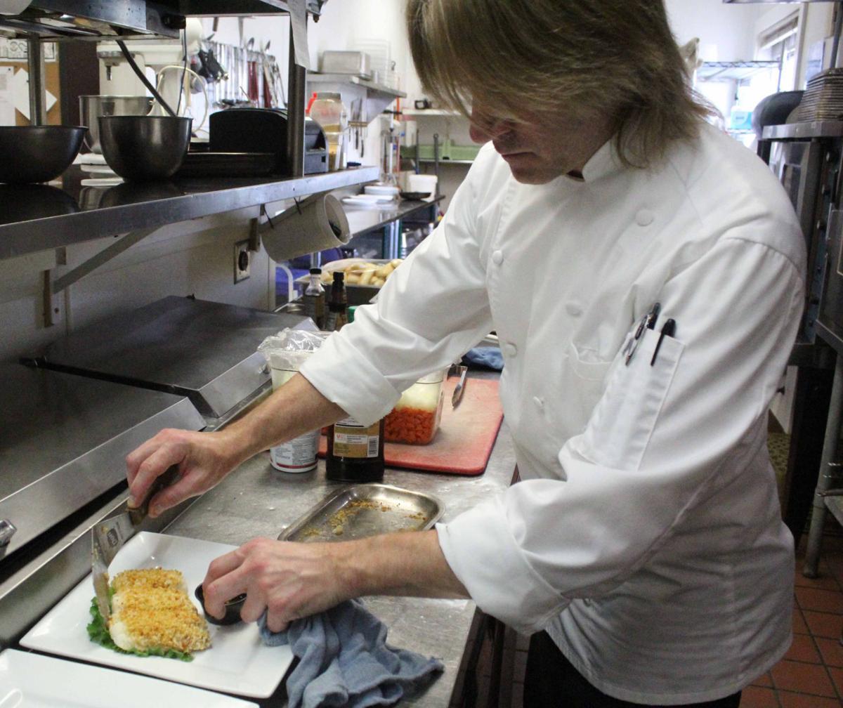 Jason prepares fish