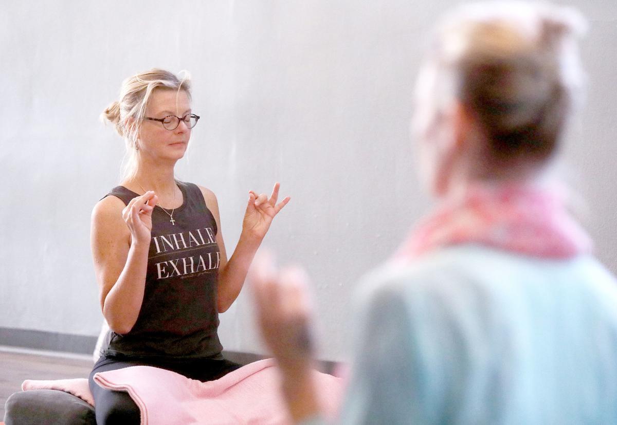 Tirner doing yoga