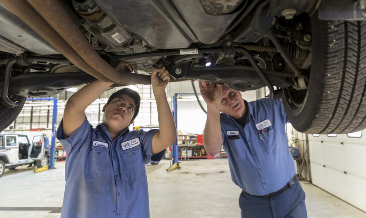 Madison students get hands-on experience working on city vehicles