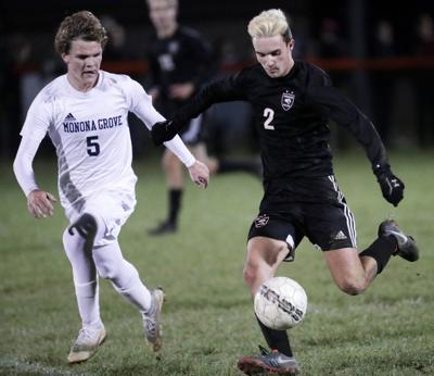WIAA boys soccer photo: Oregon's Collin Bjerke on the move