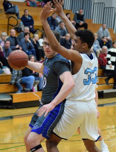 Prep basketball photo: McFarland's Trevon Chislom defends against Lodi's Cole Steinhoff