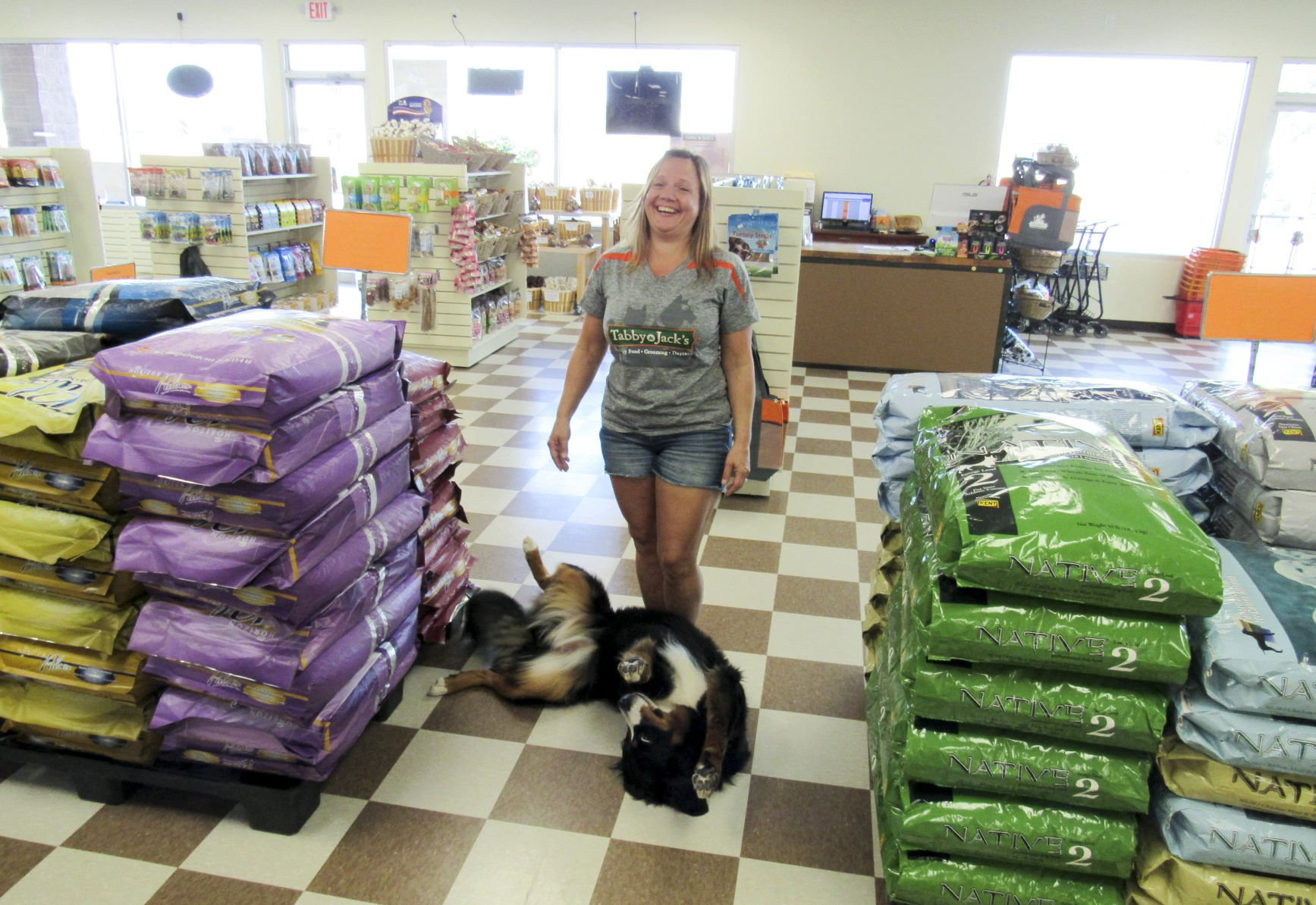 tabby \u0026 jack\u0027s continues to expand its pet supply store presence inmichelle lonergan, owner of tabby \u0026 jack\u0027s, laughs it up in her new stoughton store while her 1 year old bernese mountain dog, maisie, lobbies for a belly