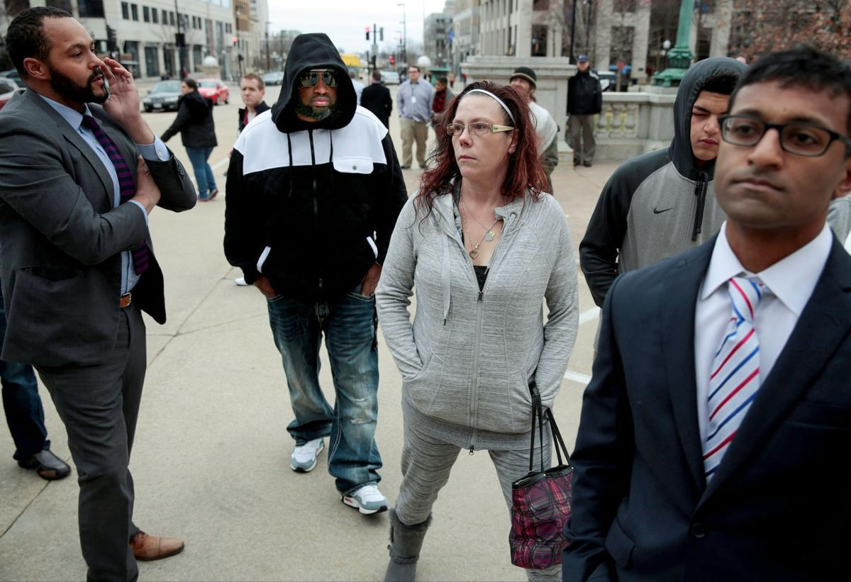 Tony Robinson's family and their lawyers arrive for a press conference Feb. 23 at the state Capitol
