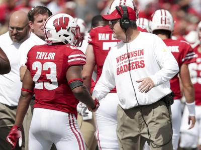 Chryst and Jonathan Taylor-AP poll