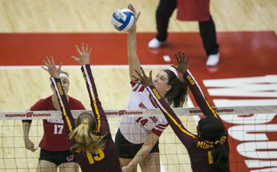 Madison Duello hits, Badgers volleyball