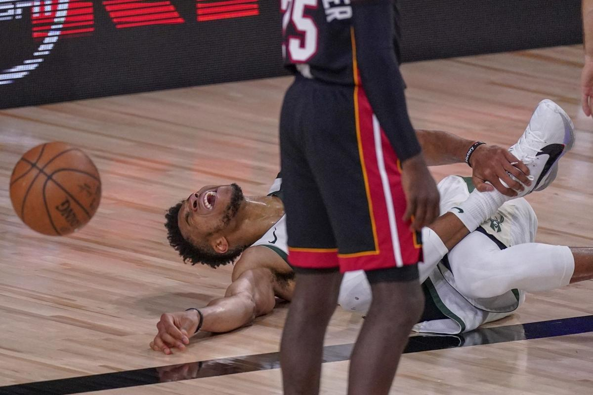 Giannis Antetokounmpo ankle injury Game 4, AP photo