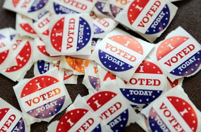 Voting buttons Russian hacking story, State Journal photo