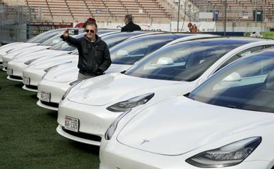 Green Cab Teslas