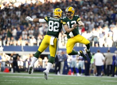 Aaron Rodgers celebrates win over Dallas, AP photo