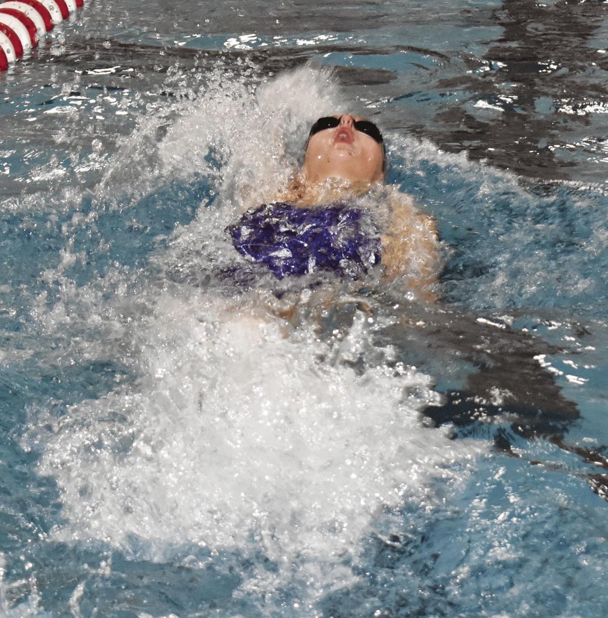 Prep girls swimming photo: McFarland's Mara Freeman swims in the backstroke relay