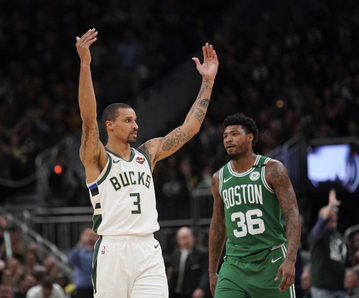 George Hill arms raised, AP photo
