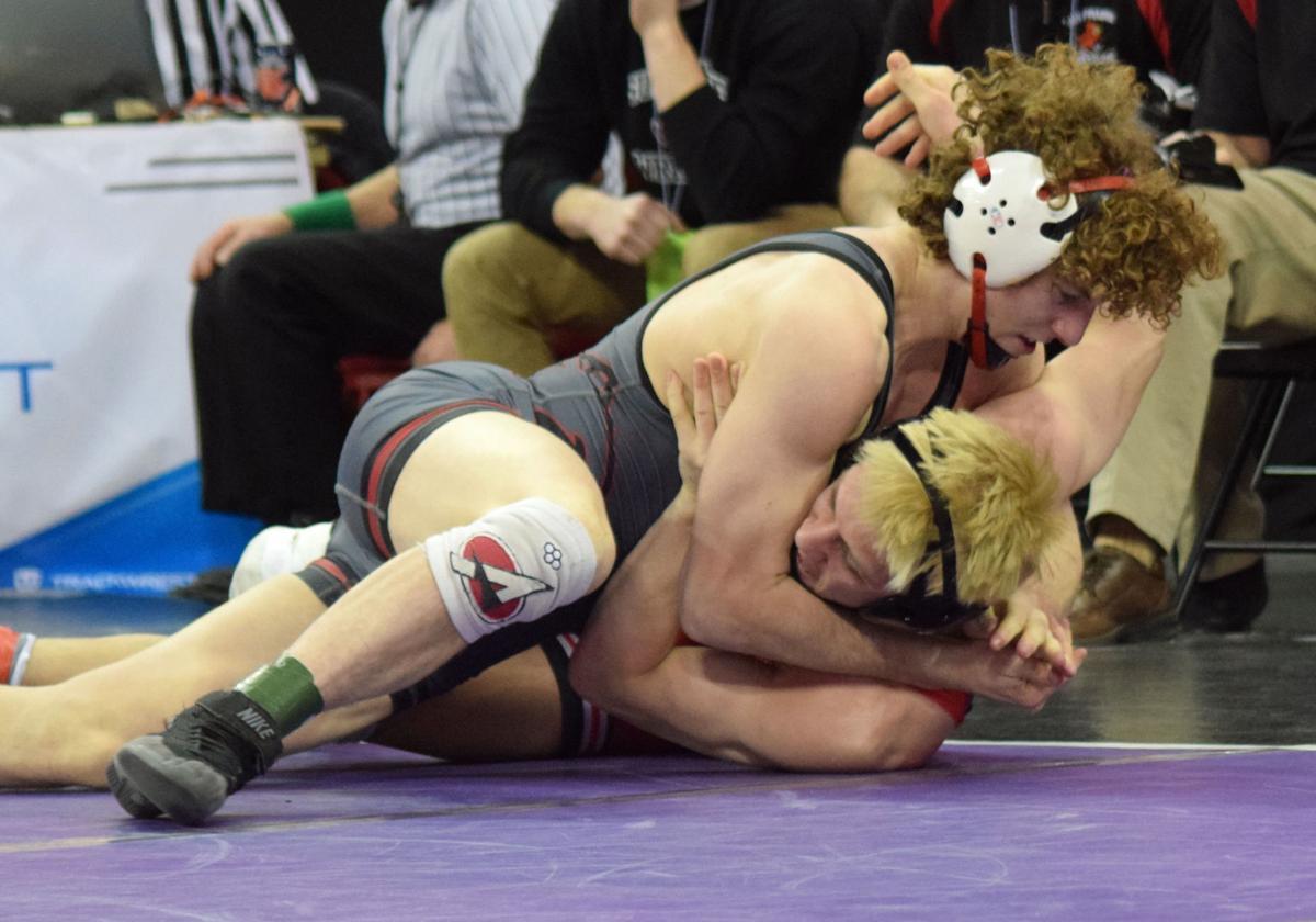 WIAA state wrestling photo: Sun Prairie's Drew Scharenbrock scores a pin