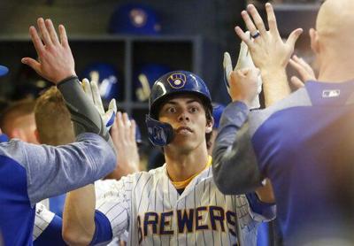Christian Yelich congratulated, AP photo