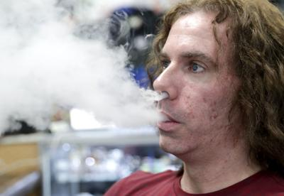 Vape shop owner vaping