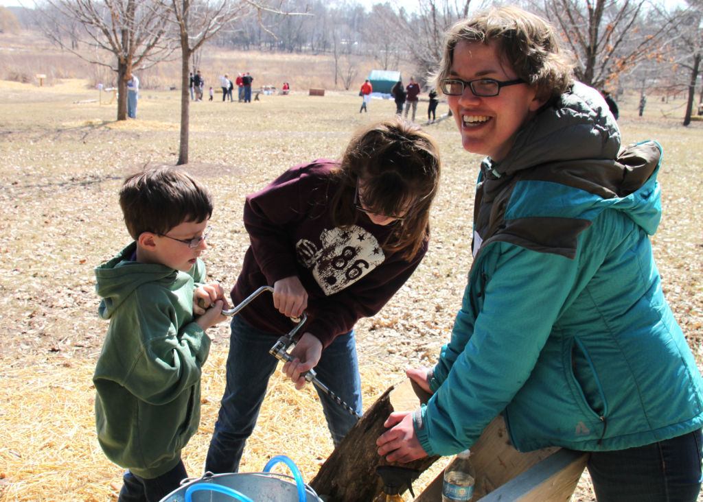 Nature center visitors try pioneer tools