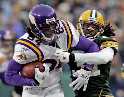 Randy Moss, Al Harris, AP photo