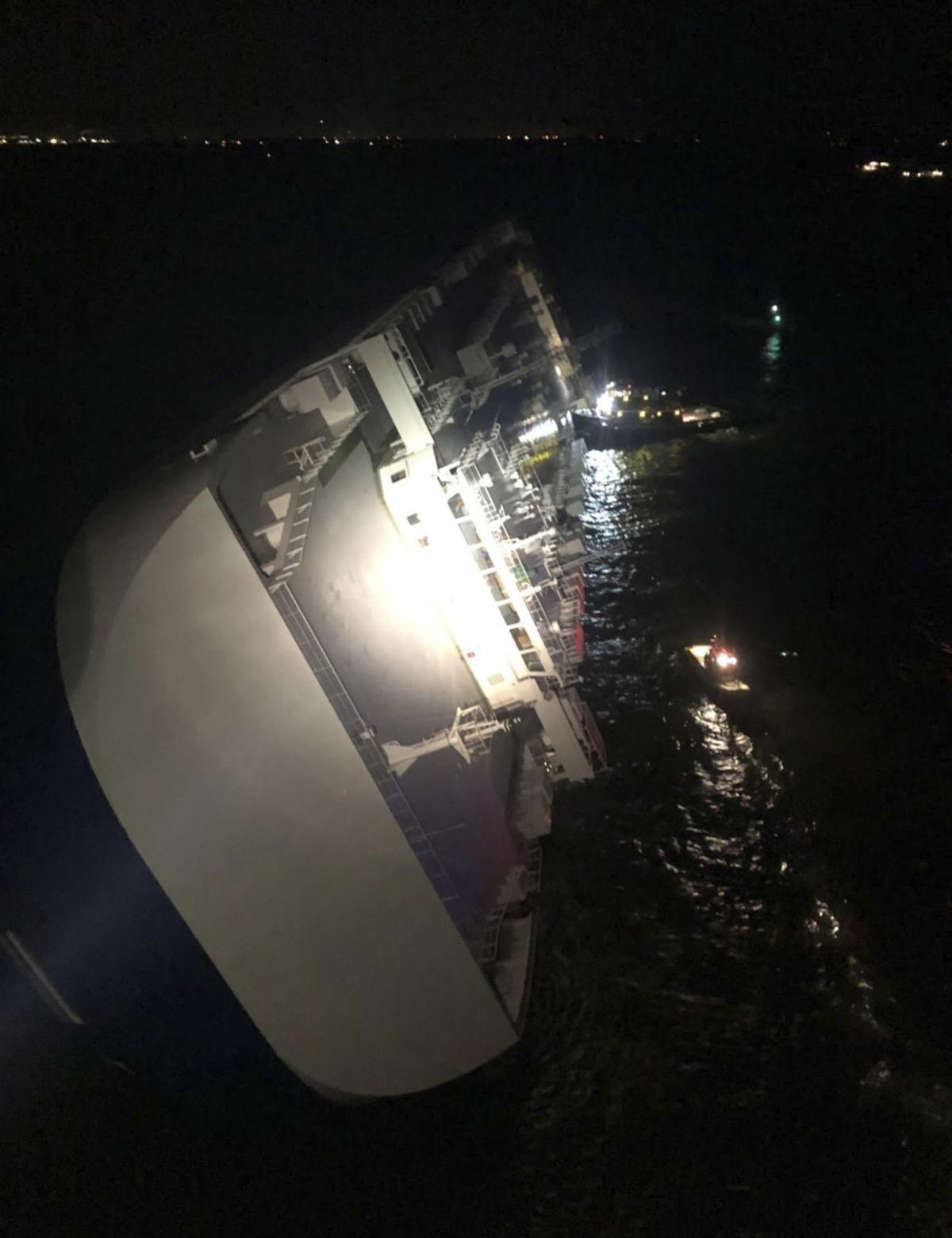 Coast Guard rescues two of four crew trapped inside capsized