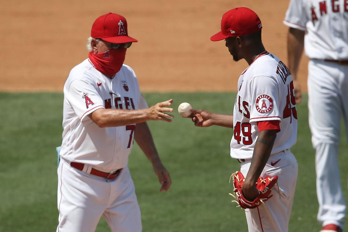 Manager Joe Maddon relieves Julio Teheran #49 of the Los Angeles Angels during the fourth inning of a game against the Los Angeles Dodgers at Angel Stadium of Anaheim on Aug. 16, 2020 in Anaheim, California.