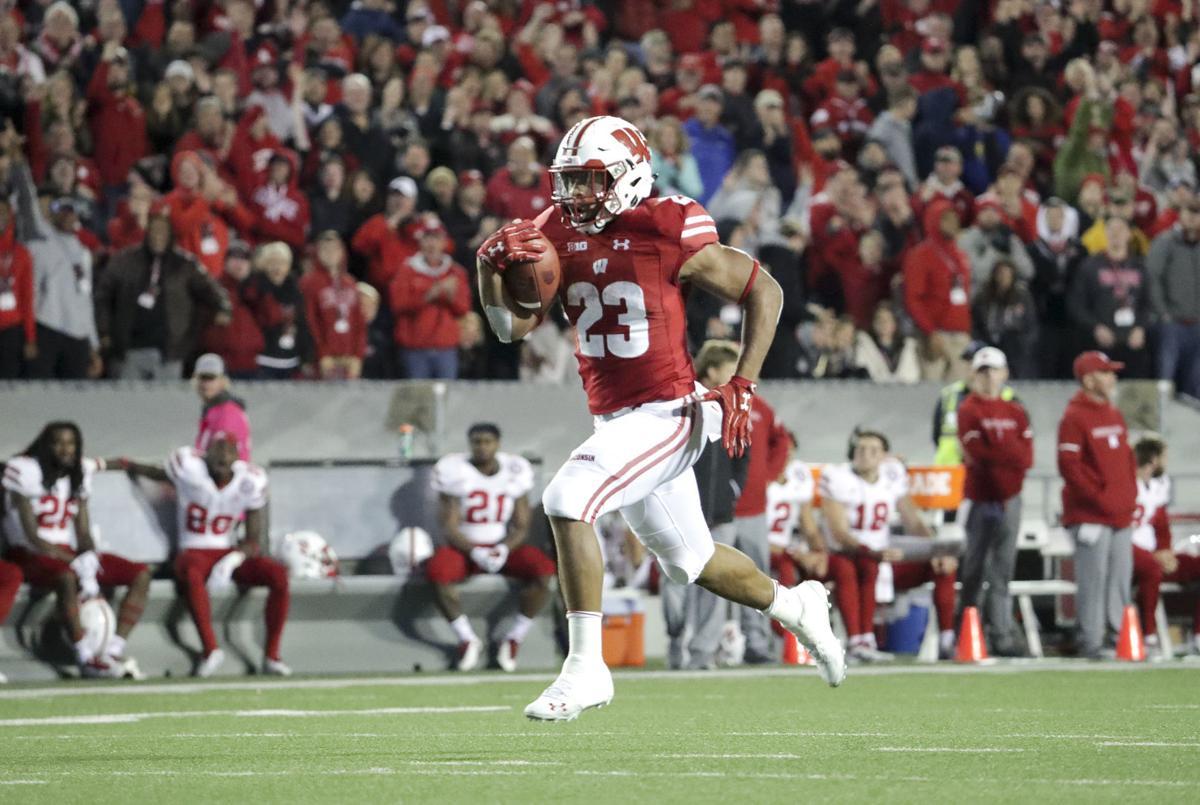Jonathan Taylor touchdown run vs Nebraska, State Journal photo