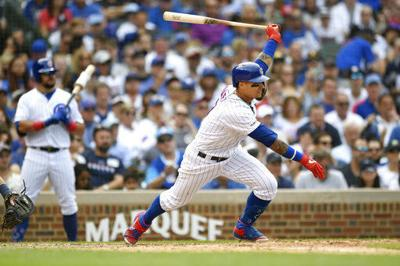 Javier Baez batting, AP photo