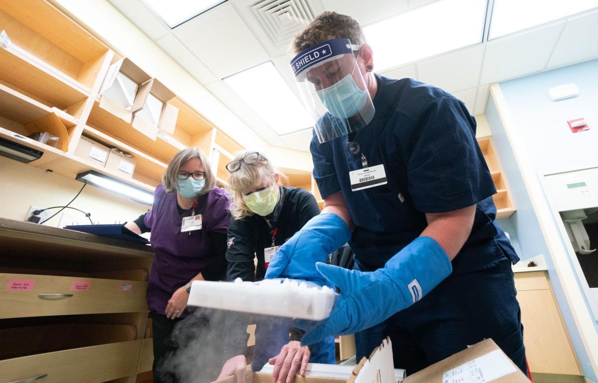 pharmacy techs handling vaccine