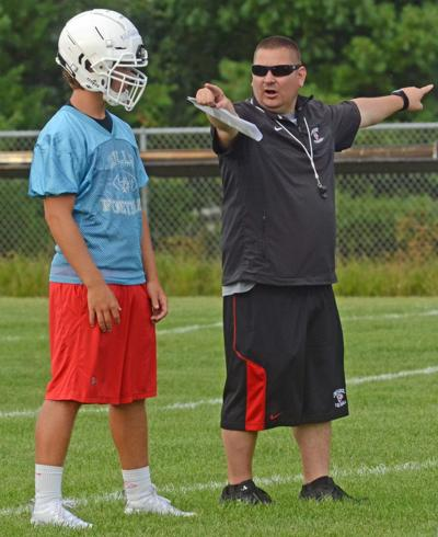 Prep football photo: Wisconsin Dells coach Scott Flood and senior Dylan Musiedlak