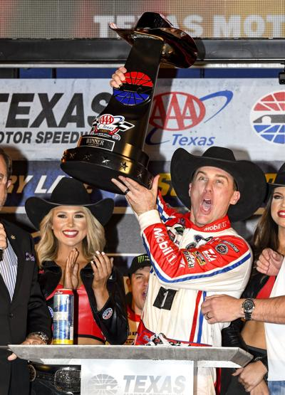 Kevin Harvick celebrates, AP photo