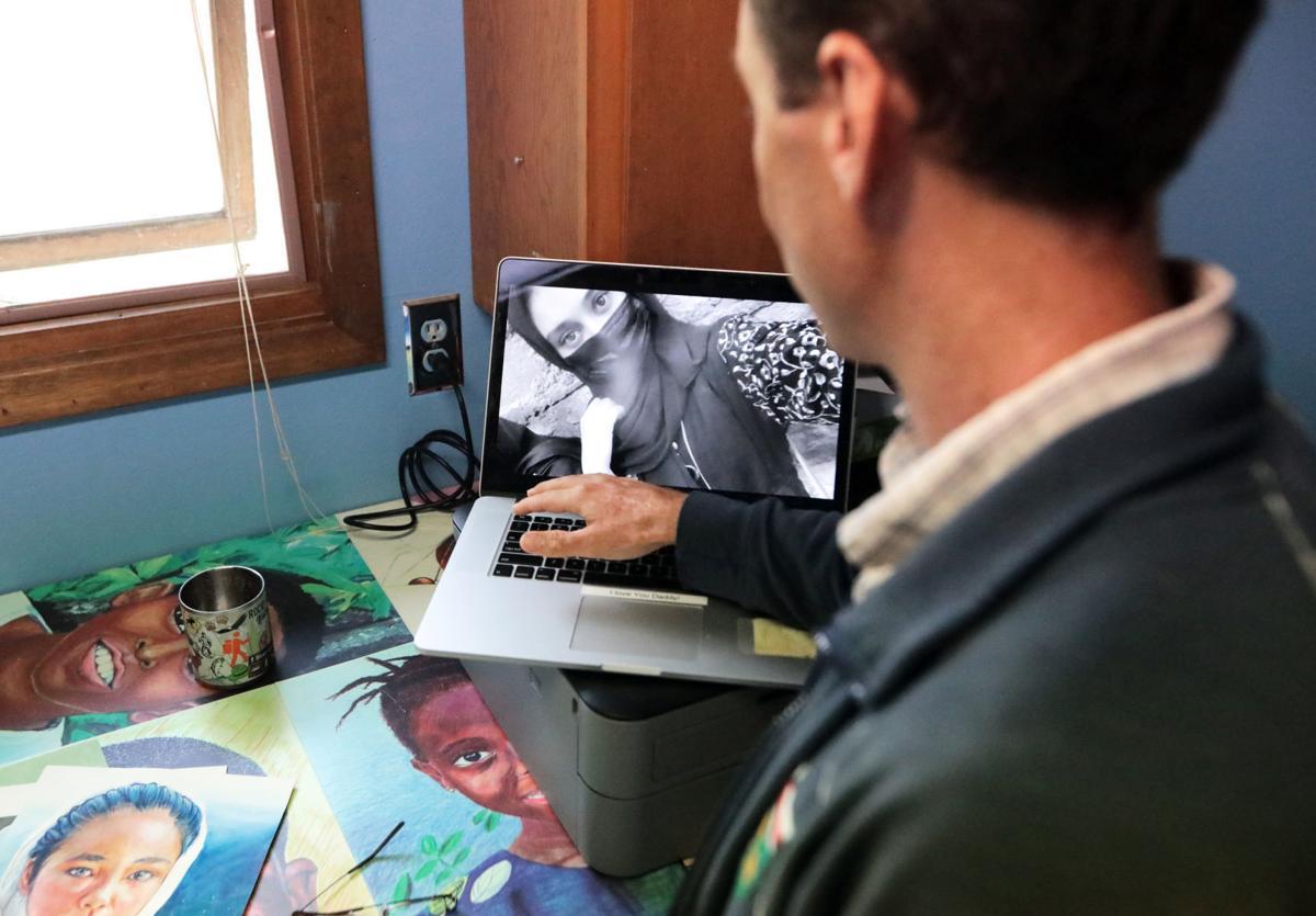 Ben Schumaker with photo of Roya