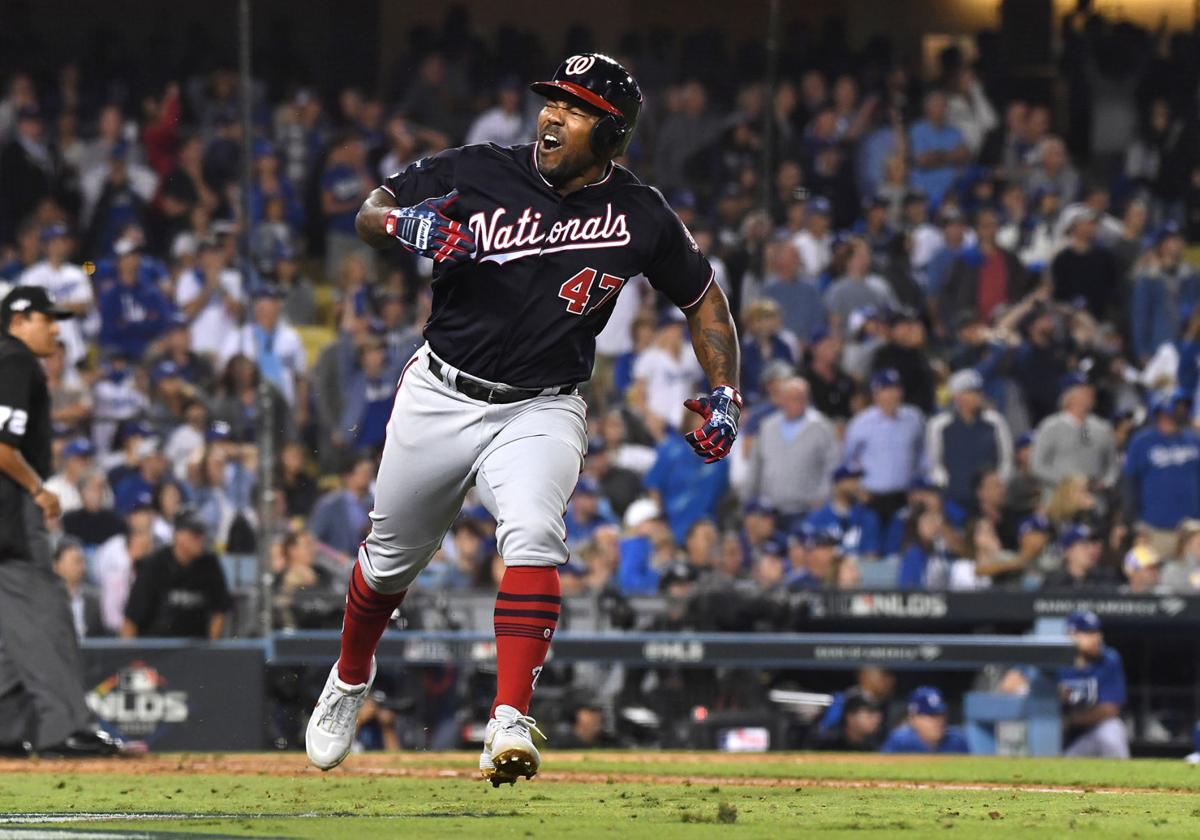 The Washington Nationals' Howie Kendrick celebrates his grand slam against the Los Angeles Dodgers in the 10th inning during Game 5 of the National League Division Series at Dodger Stadium in Los Angeles on Wednesday, Oct. 9, 2019.
