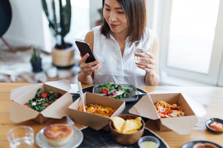 With some cards, you can use your miles to send loved ones a holiday takeout meal.