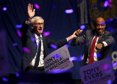 Democrat Tony Evers narrowly defeats Wisconsin Gov. Walker