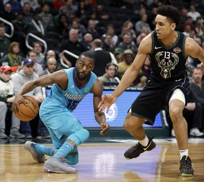 Kemba Walker, Malcolm Brogdon, AP photo
