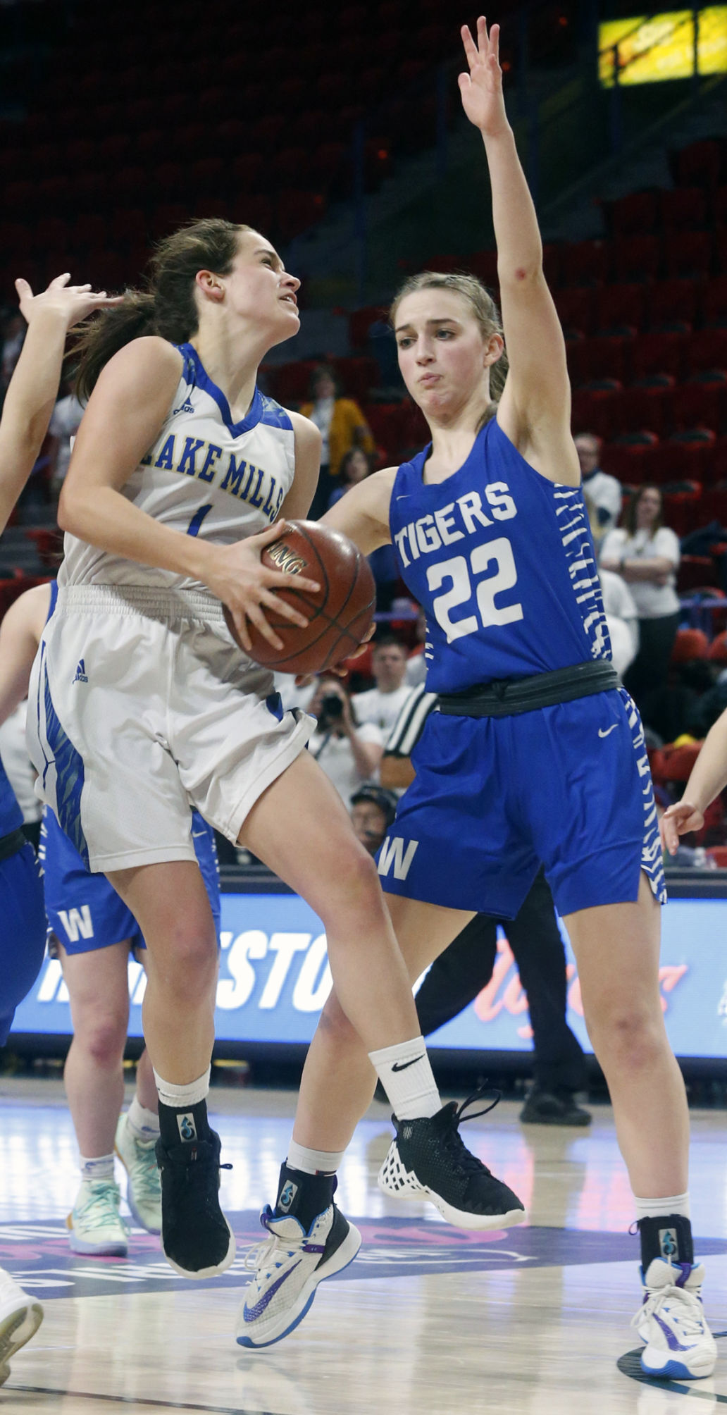 WIAA state girls basketball photo: Lake Mills' Taylor Roughen drives