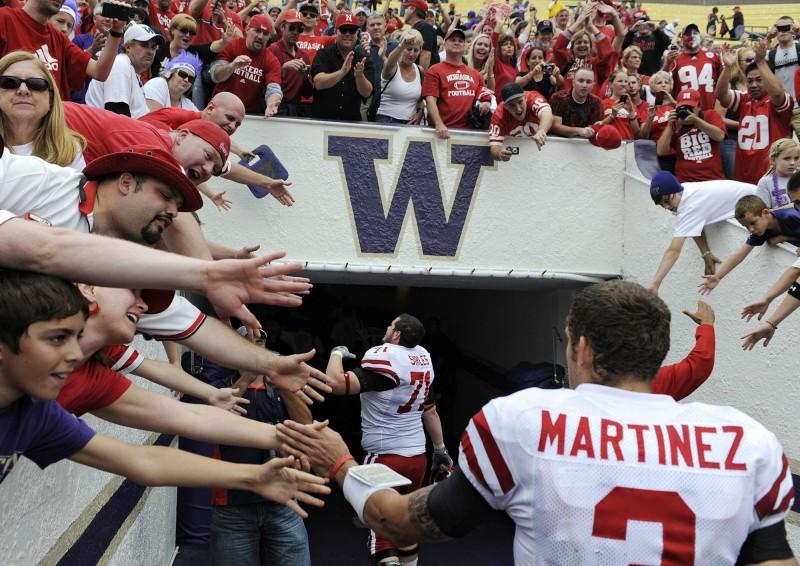 Nebraska Cornhuskers fans cheer team leaving field file photo