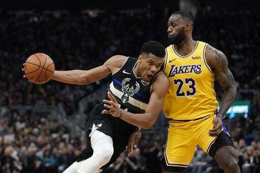 Giannis Antetokounmpo, LeBron James, AP photo