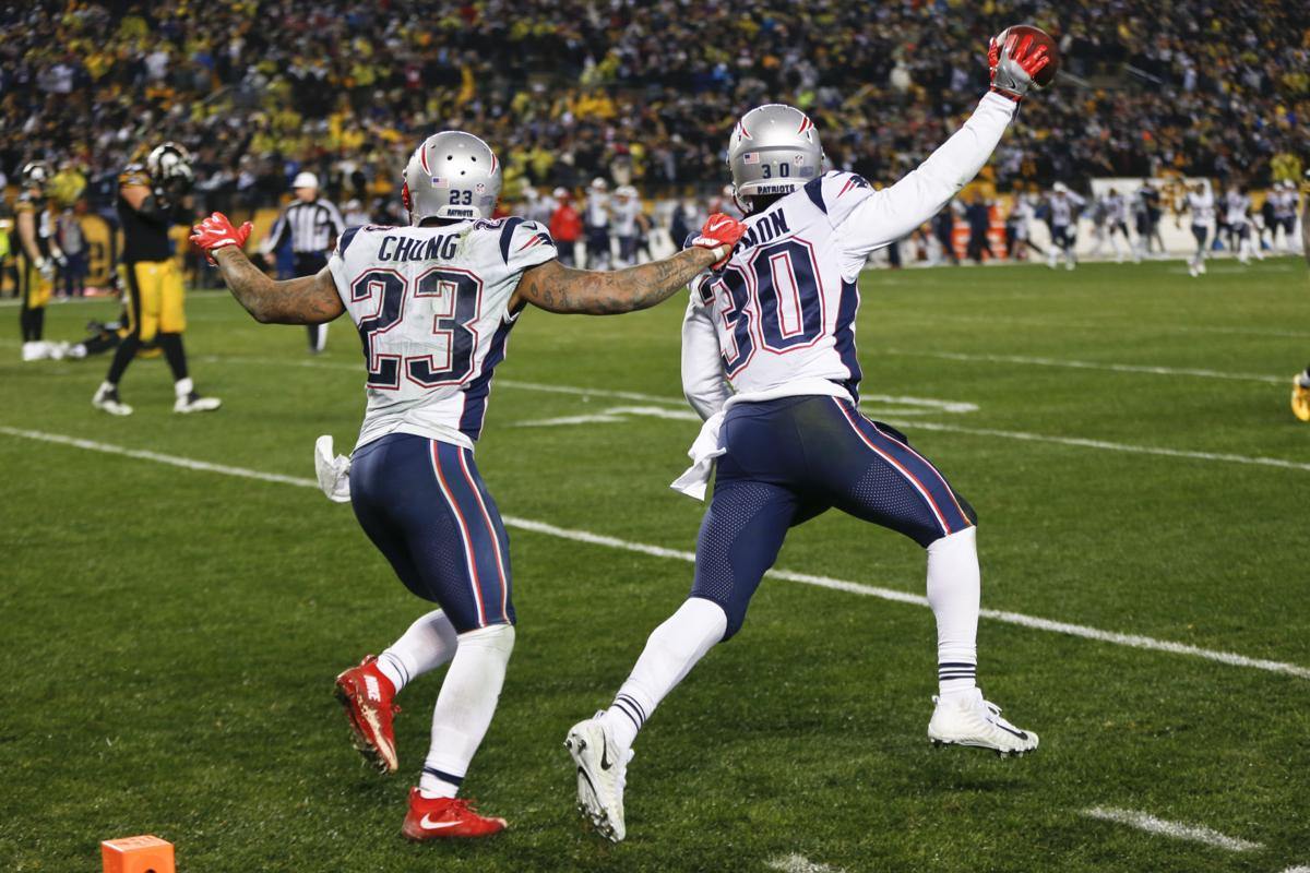 Patriots Duron Harmon, Patrick Chung celebrate, AP photo