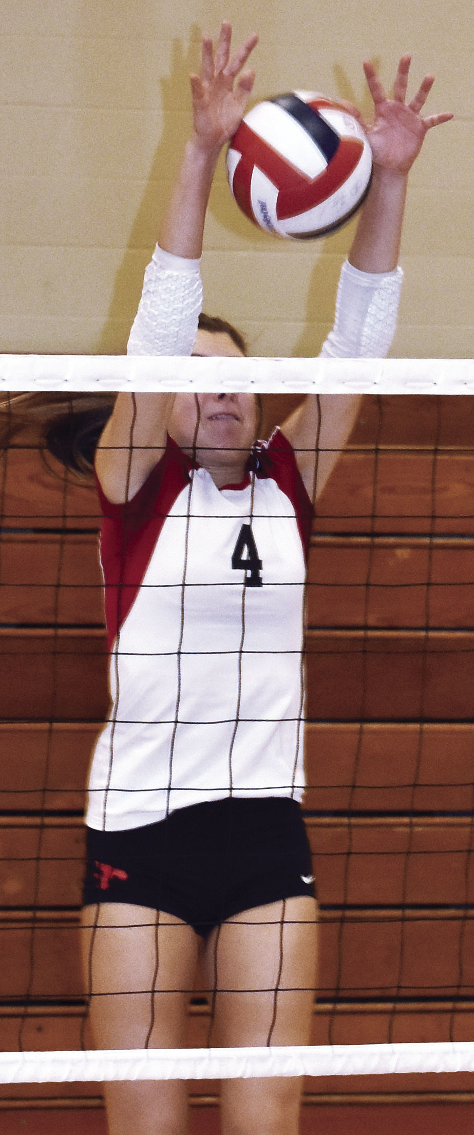 Prep girls volleyball photo: Sun Prairie junior KJ McNabb delivers a block