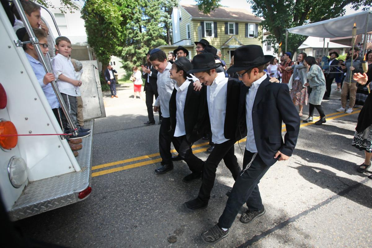Chabad of Madison welcomes new Torah scroll with song, dance