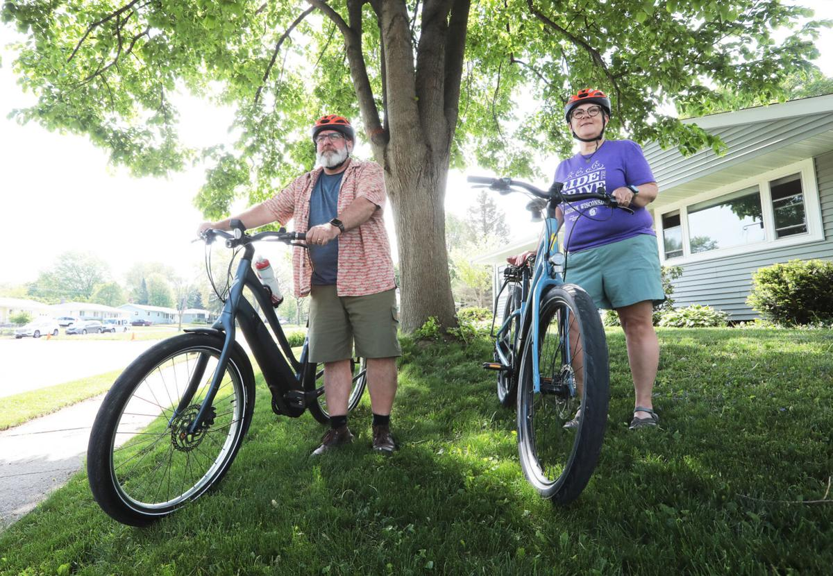 Wendy and Jeff Murkve standing with bikes