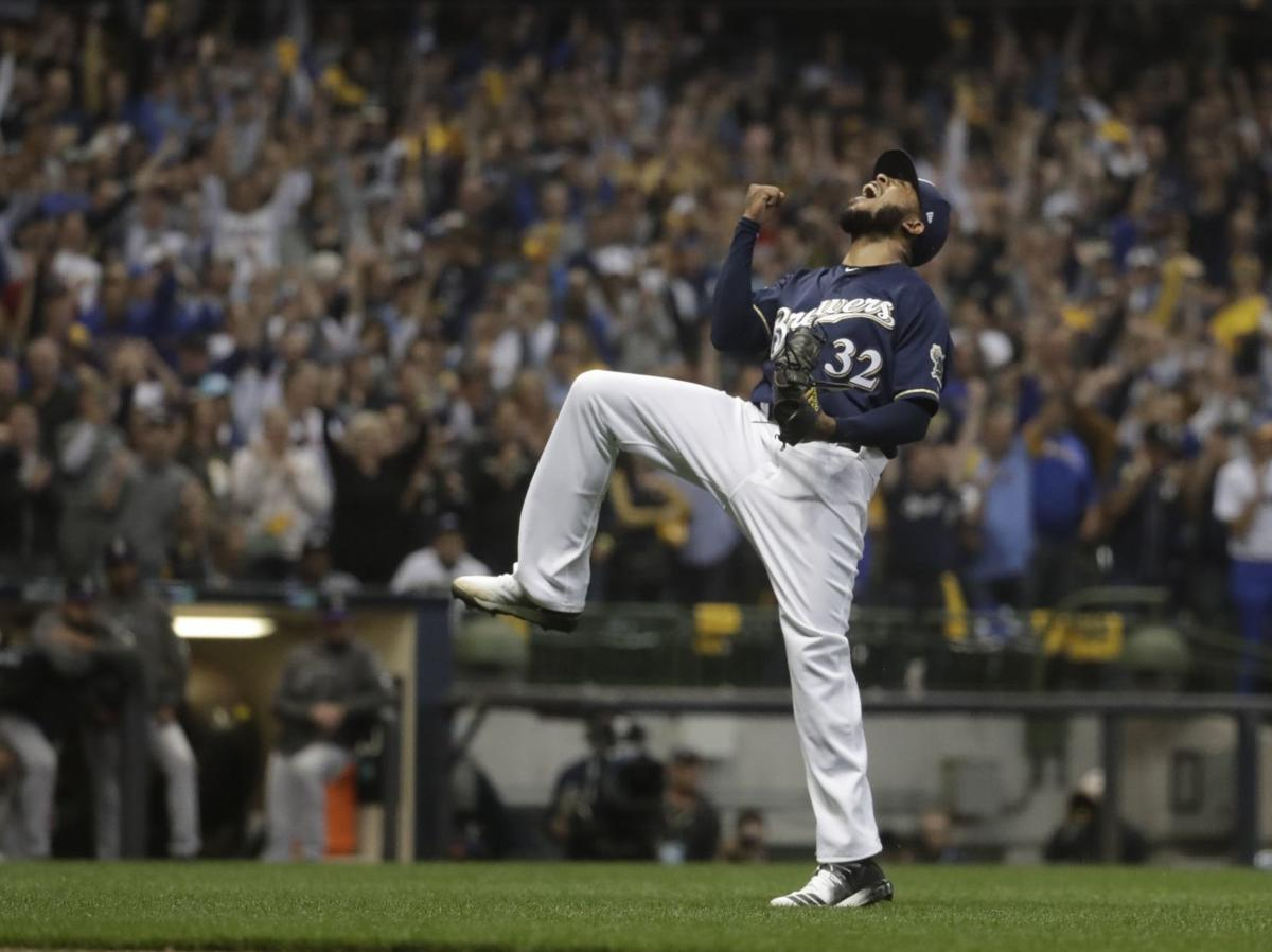 Jeremy Jeffress celebrates Game 2 NLDS, AP photo