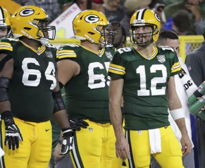packers notes photo 9-15. Aaron Rodgers smiles before taking the ... a2501f8e5