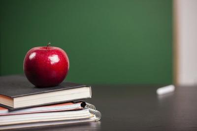 School book and apple