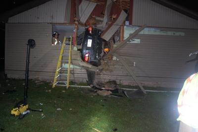 Drunken driver crashes into house, police photo