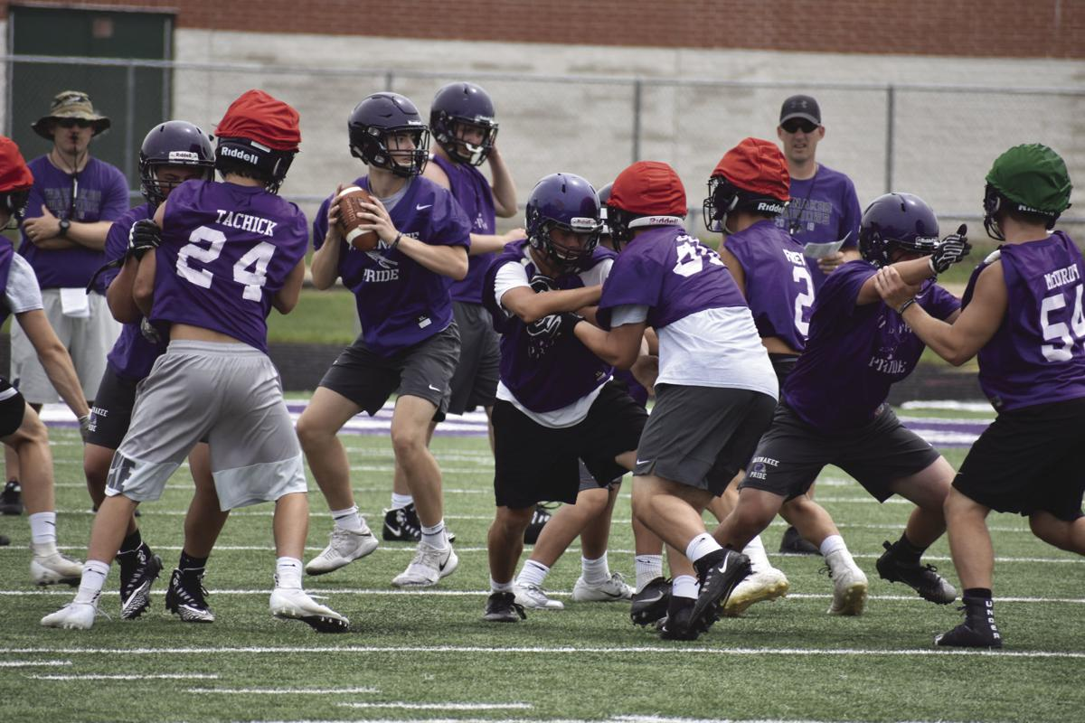 Prep football photo: Waunakee football players run a passing drill on the first day of practice